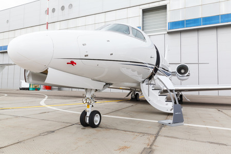 private parts: front landing gear and ladder light aircraft on the ground