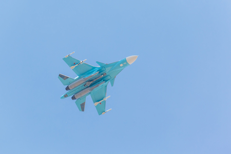 pilotage: Russian fighter demonstration flight on blue sky background Stock Photo