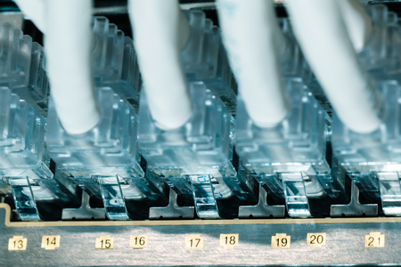 utp: RJ45 and UTP in the data center with working servers closeup Stock Photo