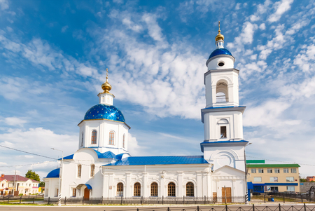 colonial church: white church on a background of blue sky in the town of Maloyaroslavets, Moscow region Stock Photo