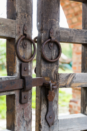 ancient prison: old wooden lattice on the gates in a monastery Russia