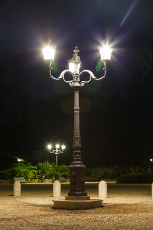 napoleon i: Old street light on Napoleon I Square. Rome at night