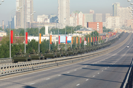 festivities: MOSCOW  RUSSIA - MAY 9: The movement of the column Russian BMP-3 amphibious infantry fighting vehicle (Infantry Combat Vehicle) on parade festivities devoted to 71 anniversary of Victory Day on May 9, 2016 in Moscow. Editorial