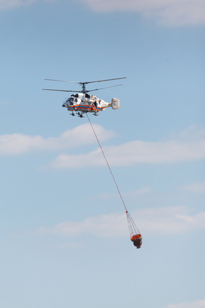 pilotage: RUSSIA, MOSCOW - AUGUST 22, 2015: The Helitack Kamov 32A in the sky on doctrines of rescuers of Ministry of Emergency Situations of Russia.
