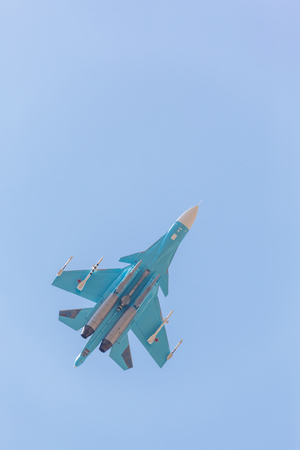 monoplane: Russian fighter demonstration flight on blue sky background Stock Photo