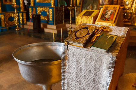 bible flower: Orthodox baptism bowl of holy water and candles. Russia