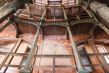 iron circular staircase in Fort Alexander Chumnoy in the Gulf of Finland