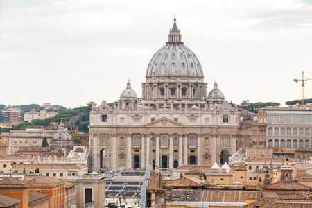 st  peter s  basilica: landscape of Rome, Angels bridge and St. Peter s basilica near river Tiber Stock Photo