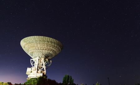 radio telescope: huge white satellite antenna radio telescope on the background of star