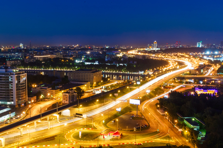 metropolis: transport metropolis, traffic and blurry lights of cars on multi-lane highways and road junction at night in Moscow Stock Photo