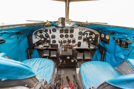 avionics: Engine Controls and other devices in the cockpit of an old airplane