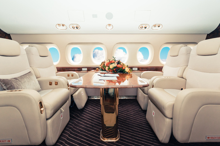 Luxury interior in bright colors of genuine leather in the business jet Stok Fotoğraf - 65760209