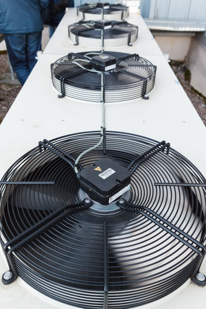 Cooling industrial air conditioning units closeup. Fans on condenser Stock Photo