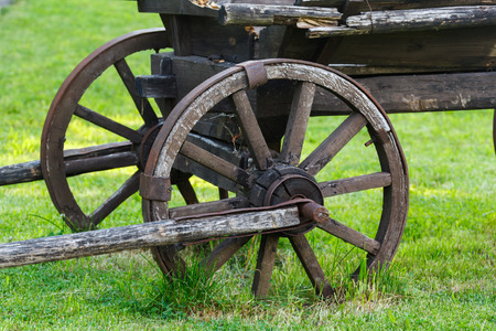 Old wooden cartwheel closeup Stock Photo