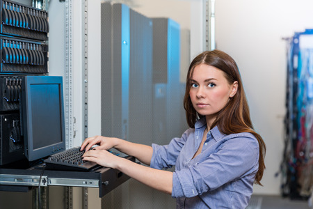 nas: Young engineer and businesswoman with the management console