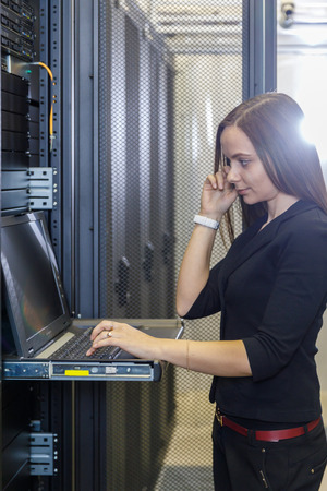 nas: Young woman engineer with the management console