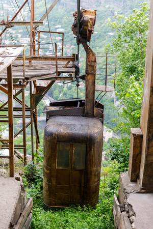 Old soviet rusty and functioning ropeway or cable car cabins in Chiatura