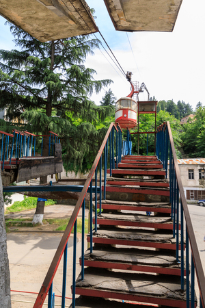 Cable car station, Old soviet rusty and functioning ropeway or cable car cabins in Chiatura, Georgia Stock Photo