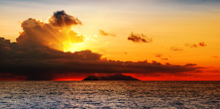 Dramatic sky during a hurricane and sunset over the ocean. Seychelles