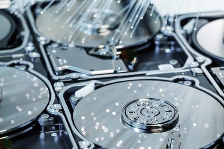 Server hard disks, illuminated optical fiber with blurred lights.