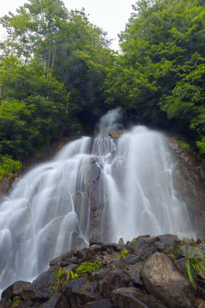 Beautiful natural canyon and amazing waterfall of the mountain river at the rain. canyon in Georgia.