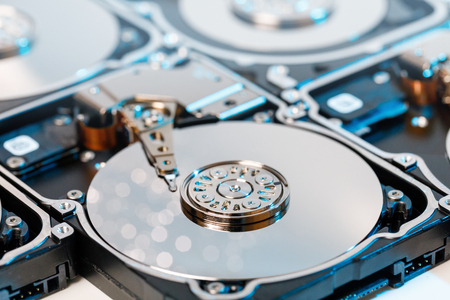close up of disassembled hard disk with abstract reflection. Stock Photo