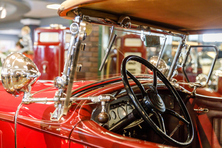 Detail of the interior of an old car in a garage.