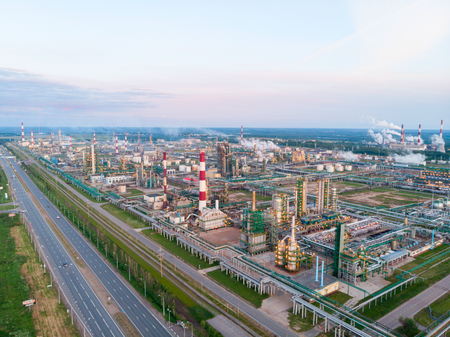Oil refinery plant industry, Refinery factory, oil storage tank and pipeline steel with sunrise and cloudy sky background, Russia.