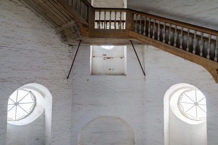 wooden spiral staircase in the ancient bell tower of the Orthodox Church. Vologda