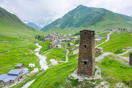 View of the Ushguli village at the foot of Mt. Shkhara. Picturesque and gorgeous scene. Rock tower towers and old houses in Ushguli