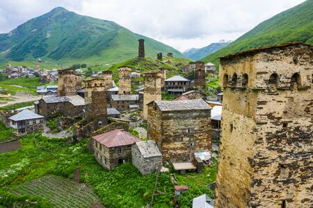 View of the Ushguli village at the foot of Mt. Shkhara. Picturesque and gorgeous scene. Rock tower towers and old houses in Ushguli.