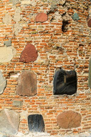 Texture of the old walls of clay brick, decorated with inserts of colored stones in the shape of crosses. Boris and Gleb (Kalozha) church, Grodno, Belarus. Reklamní fotografie