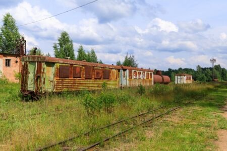 abandoned narrow gauge railway, Branches of the railway at the marshalling yard, forest and lonely road in the middle Russia.