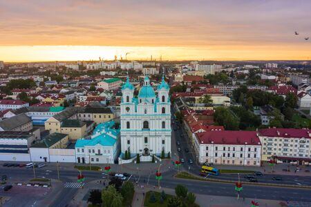 St. Francis Xavier Cathedral And Traffic In Mostowaja And Kirova Streets in the morning light. Grodno city in Belarus. Aerial view from a drone. 写真素材 - 132123605