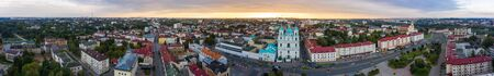 panorama of the city of Grodno and St. Francis Xavier Cathedral And Traffic In Mostowaja And Kirova Streets in the morning light. Grodno city in Belarus. Aerial view from a drone.