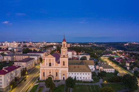 Holy Cross Church And Traffic In Mostowaja And Kirova Streets in the morning light. Grodno city in Belarus. Aerial view from a drone. 写真素材