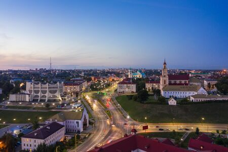 Grodno Regional Drama Theater and Holy Cross Church And Traffic In Mostowaja And Kirova Streets in the morning light. Grodno city in Belarus. Aerial view from a drone. 写真素材