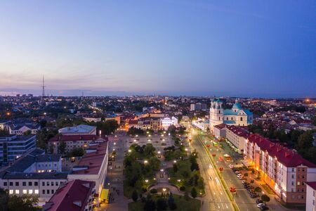 St. Francis Xavier Cathedral And Traffic In Mostowaja And Kirova Streets in the morning light. Grodno city in Belarus. Aerial view from a drone.