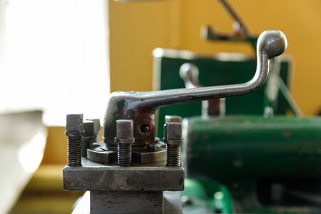 spindle, tool holder and old green lathe machine tool equipment.