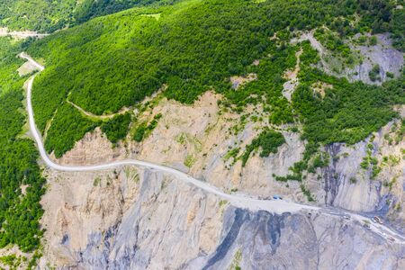 Amazing view of the landslide on a mountain road. The road from Mestia to Zugdidi was blocked by an rockfall. Road services are clearing the mountain road serpentine.