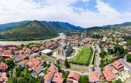 Panoramic view of Mtskheta, The Old Town Lies At The Confluence Of The Rivers Mtkvari And Aragvi. Svetitskhoveli Cathedral, Ancient Georgian Orthodox Church,   In The Center. Stock Photo