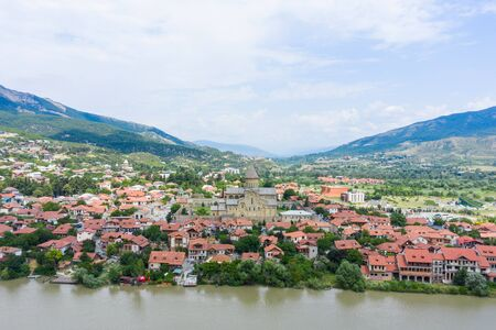 Panoramic view of Mtskheta, The Old Town Lies At The Confluence Of The Rivers Mtkvari And Aragvi. Svetitskhoveli Cathedral, Ancient Georgian Orthodox Church,   In The Center. Reklamní fotografie