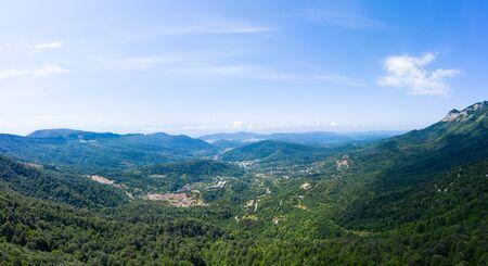 Amazing view of the landslide on a mountain road near Naqerala Pass and Cxrajvari mountain. Serpentine road and and view of the city of Tkibuli. Georgia 版權商用圖片