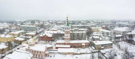 The old bell tower of red brick in Slobodskoy, Kirov. Winter view from drone.