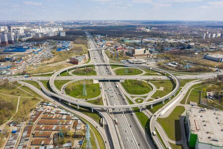 Top view of the multi-level road junction in Moscow from above, car traffic and many cars, the concept of transportation. road junction at the intersection of the Kashirskoe highway and ring road.