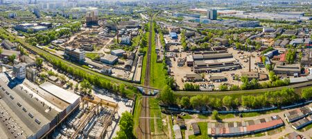 Aerial top view of road junction in Moscow from above, automobile traffic in the Moscow industrial zone near the automobile ring highway.