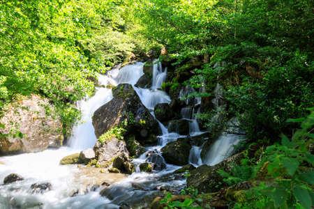 Georgia mountain road to Mestia region, one of many beautiful waterfalls next to the road.