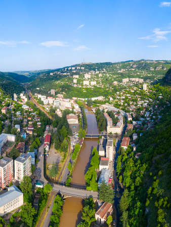 The city of Chiatura located in the gorge of the Kvirila River, a tributary of the Rioni and on adjacent plateaus. Panorama of the city district and apartment buildings on the rock and Upper cable car station Perevisa.