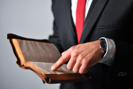 Businessman in a suit holding a book photo