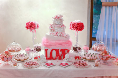 Wedding cake and banquet table photo